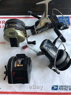 8 Vintage Reels AsIs-Zebco Cardinal 554 Starlite Silstar Zebco 404 Lightning 404