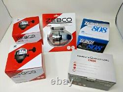 Lot Of 4 Vintage Zebco Reels & A Quantum Reel withoriginal boxes Fishing Reels