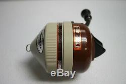 Vintage Zebco 808 Brown Metal Foot Spin-Cast Fishing Reel. Excellent! NOS # 22